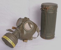 Image of WWII GERMAN GAS MASK (RESPIRATOR) AND TIN, 1944