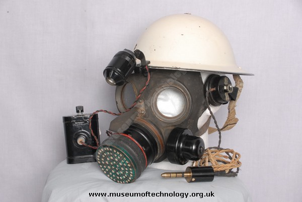 WWII GAS MASK (RESPIRATOR)  WITH MICROPHONE AND WARDENS HELMET, 1938