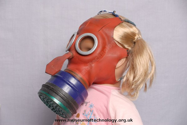 WWII MICKEY MOUSE GAS MASK ON TODDLERS HEAD