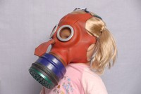 Image of WWII MICKEY MOUSE GAS MASK ON TODDLERS HEAD